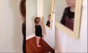 Toddler oves her reflection