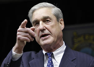 In this Jan. 9, 2011, file photo, FBI Director Robert S. Mueller III speaks in Tucson, Ariz.