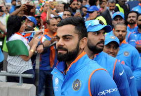 India captain Virat Kohli leads his players onto the field