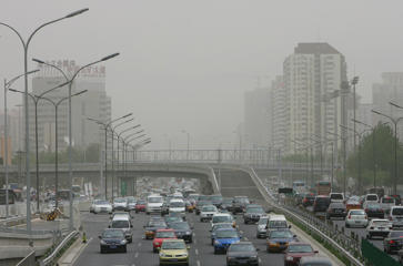 Cars drive in both directions on May 27, 2008 in Beijing, China. The International Olympic Committee (IOC) has warned some outdoor events could be at risk at being postponed because of Beijing's poor air pollution.