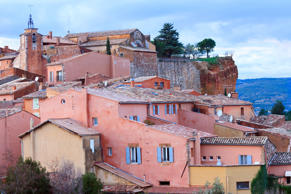 'The french village Roussillon, which is famous for it's ochre colored facades and stone walls in a wide spectrum from yellow, orange, red to brown. Located in the french department Vaucluse, Provence-Alpes-Cote d'Azur, Southern France, in the North of t