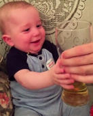 Eight-month-old baby loves beer