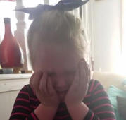 Girl cries after news on baby sis
