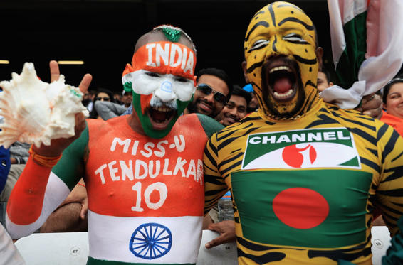 Slide 1 of 12: A Indian and Bangladesh fan show their support during the ICC Champions Trophy Semi Final match between Bangladesh and India at Edgbaston on June 15, 2017 in Birmingham, England.