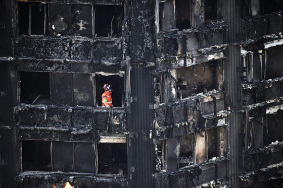 Slide 2 of 102: A member of the emergency services works inside the Grenfell apartment tower block in North Kensington, London, Britain, June 17, 2017. REUTERS/Hannah McKay