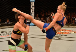 Holly Holm knocks out Bethe Correia of Brazil with a kick in their women's bantamweight bout during the UFC Fight Night on Saturday in Singapore.