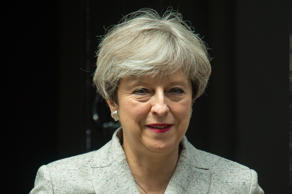 Prime Minister Theresa May leaving 10 Downing Street in London during talks with DUP leader Arlene Foster and DUP deputy leader Nigel Dodds on a deal to prop up a Tory minority administration.