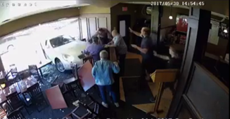 Diner miraculously walks away after car smashes through restaurant window