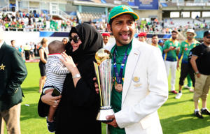 Sarfraz Ahmed of Pakistan poses with the trophy.