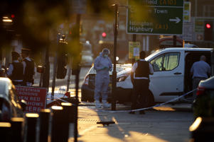 Forensic investigators work the scene in the Finsbury Park area of north London after a vehichle hit pedestrians, on June 19, 2017.