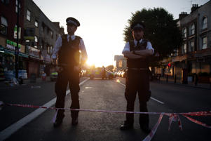 Police guard a street in the Finsbury Park area of north London after a vehichle hit pedestrians, on June 19, 2017.