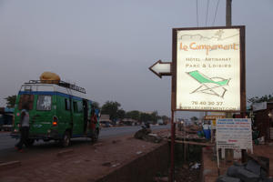 A sign points to Campement Kangaba, a hotel resort, near Bamako, Mali, Sunday, June 18, 2017. Suspected jihadists attacked the hotel resort Sunday in Mali's capital, taking hostages at a spot popular with foreigners on the weekends.