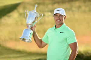 Jun 18, 2017; Erin, WI, USA; Brooks Koepka poses with the trophy after winning the U.S. Open golf tournament at Erin Hills.