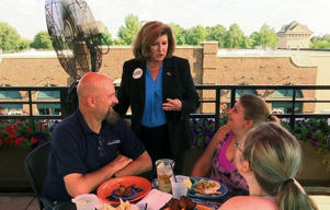 Republican Karen Handel campaigns at a restaurant in Johns Creek, Ga., Friday, June 16, 2017, ahead of runoff election to replace former Rep. Tom Price.