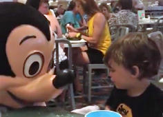 Disabled boy loves Mickey Mouse
