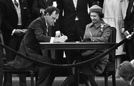 Canadian Attorney General Jean Chretien signs the proclamation repatriating Canada's constitution while Queen Elizabeth II watches in Ottawa on April 17, 1982.