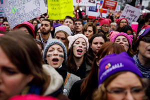 Women sing along as thousands pack the streets for the Women's March on Washington rally outside the National Museum of the American Indian in Washington, D.C., on Saturday, Jan. 21, 2017. A new study has found that social and structural barriers continue to obstruct the advancement of female members of Generation X and millennials.