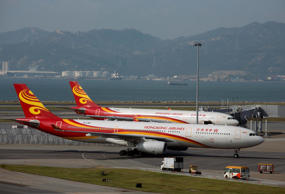 A Hong Kong airlines passenger plane taxies on the tarmac at the Hong Kong Airport September 11, 2013. The Civil Aviation Department said that the current hourly Chek Lap Kok airport runway capacity reached 64 sorties, an increase of 24 sorties since 199