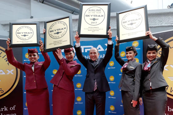 Slide 1 of 26: Akbar Al Baker, Qatar Airways Chief Executive Officer, poses with flight crew members after his company was announced the World's Best Airline along with other awards at the SKYTRAX 2017 World Airline Awards during the 52nd International Paris Air Show at Le Bourget Airport on June 20, 2017, in Paris, France.