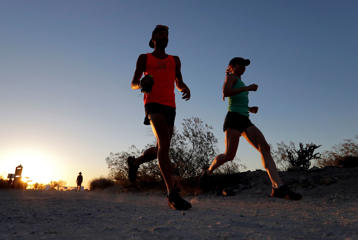 A couple runs through section of South Mountain Park at sunrise to avoid the excessive heat, Friday, June 16, 2017 in Phoenix. A record heat wave is rolling into Arizona, Nevada and California that threatens to bring 120-degree temperatures to Phoenix by early next week.