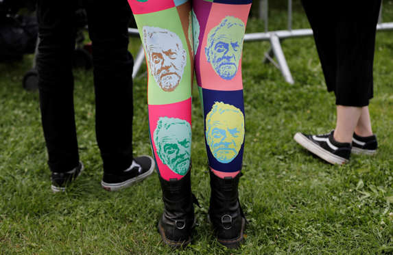 Slide 18 de 36: A woman wears tights showing the face of Jeremy Corbyn, leader of Britain's opposition Labour Party, at a campaign rally in Birmingham, Britain June 6, 2017. REUTERS/Darren Staples TPX IMAGES OF THE