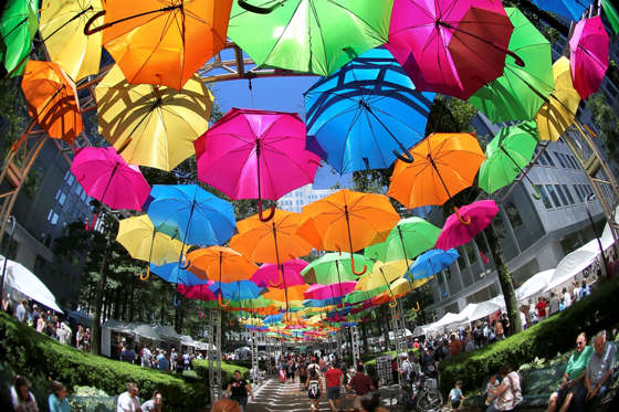 Slide 9 de 36: In this image made with a fisheye lens, an array of umbrellas covers a walkway at the annual Three Rivers Arts Festival on Saturday, June 3, 2017, in Pittsburgh. According to the festival guide, the feature is part of The Umbrella Sky Project that origin