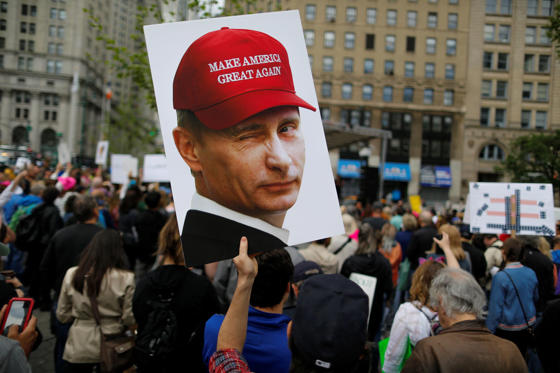 Slide 10 de 36: NEW YORK, NY - JUNE 03: A demonstrator holds up a sign of Vladimir Putin during an anti-Trump 'March for Truth' rally on June 3, 2017 in New York City. Rallies and marches are taking place across the country to call for urgent investigation into possible