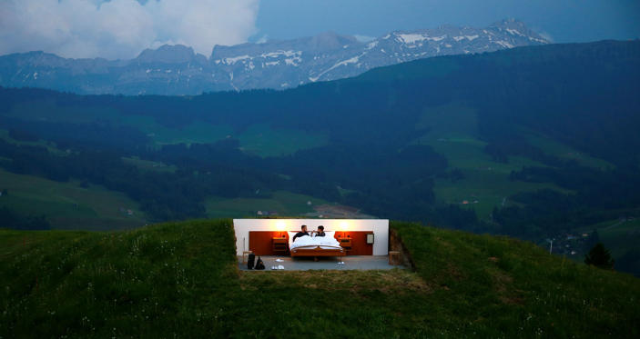 Slide 12 de 36: Raphael and Mirjam (R) pose as first guests in the bedroom of the Null-Stern-Hotel (Zero-star-hotel) land art installation by Swiss artists Frank and Patrik Riklin on an alp mount Saentis near Gonten, Switzerland June 1, 2017. Guests can order overnight