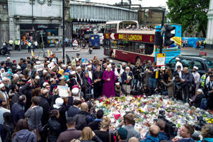 Imams and members of the Muslim community arrive to lay flowers near the scene of the London Bridge terrorist attacks, on June 7, 2017 in London, England. The third attacker has been named following the attack on Saturday night in London Bridge and Borough in which eight people were killed and forty eight were injured.