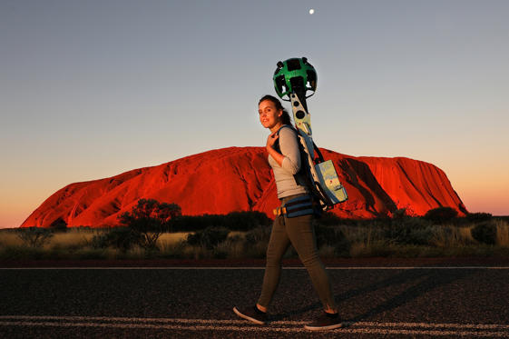 Slide 28 de 36: A handout image of Lindsey Dixon carrying the Google Street View Trekker camera on her back as part of a promotional event in front of Uluru, also known as Ayers Rock, located in the Northern Territory, Australia, June 7, 2017. Chris Pavlich/Handout via
