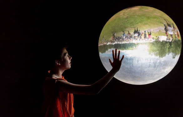 Slide 6 de 36: A boy looks at a glass bowl showing the outside upside down in a museum in Bramsche-Kalkriese, Germany, Sunday, June 4, 2017. (Guido Kirchner/dpa via AP)