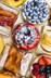 VARIOUS Background of assorted fresh sweet tarts and pastries from above