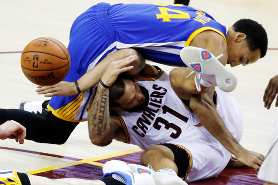 Slide 4 of 30: Golden State Warriors guard Shaun Livingston (34) lands on Cleveland Cavaliers guard Deron Williams (31) during the second half of Game 4 of basketball's NBA Finals in Cleveland, on June 9.
