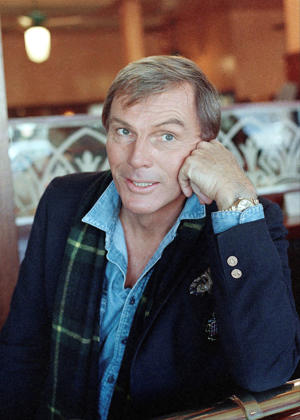 FILE - In this Dec. 11, 1985, file photo, Adam West poses for a photo in Los Angeles. On Saturday, June 10, 2017, his family said the actor, who portrayed Batman in a 1960s TV series, has died at age 88. (AP Photo/Lennox McLendon, File)