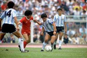 Argentina's Diego Maradona (r) holds off a challenge from South Korea's Park Chang-sun  (Photo by Peter Robinson - EMPICS/PA Images via Getty Images)