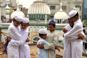 Indian Muslims embrace after offering Eid prayers on the occasion of the Eid al-Fitr festival which marks the end of the holy month of Ramadan at the Kharudin Mosque in Amritsar on July 7, 2016. The three-day festival, which begins after the sighting of a new crescent moon, marks the end of the fasting month of Ramadan during which devout Muslims abstain from food and drink from dawn to dusk.