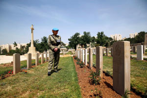 Gravestones after the annual ANZAC Day memorial ceremony at the Commonwealth War Graves Cemetery in Jerusalem.