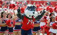 Fresno State's Timeout mascot runs in with the cheerleaders before the game against Tulsa during the first half of an NCAA college football game in Fresno, Calif., Saturday, Sep. 24, 2016.