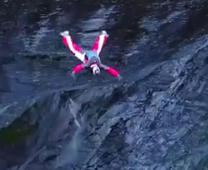 Base jumpers' free fall from cliff