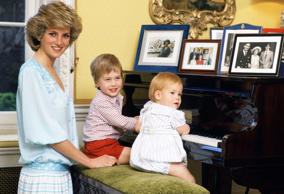OCTOBER 04: Diana, Princess of Wales with her sons, Prince William and Prince Harry, at the piano in Kensington Palace