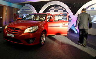 A guest checks out the Hyundai's new Verna Transform car during its launch in Bangalore, India, Thursday, June 24, 2010