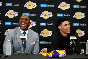 Los Angeles Lakers draft pick Lonzo Ball, right, and Magic Johnson smile as they answer questions during the NBA basketball team's news conference, Friday, June 23, 2017, in El Segundo, Calif.