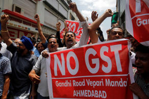 Traders shout slogans during a day-long strike against Goods and Services Tax (GST), set to be launched from July 1, in Ahmedabad, India, June 15, 2017.