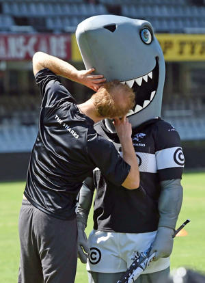 DURBAN, SOUTH AFRICA - DECEMBER 01: (HELLO! MAGAZINE OUT) Prince Harry jokes around the mascot of The Sharks rugby club at Kings Park Stadium during an official visit to Africa on December 1, 2015 in Durban, South Africa. (Photo by Samir Hussein/Pool/WireImage)