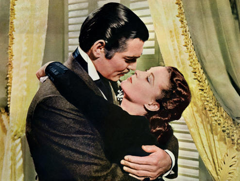 Slide 1 of 57: Rhett Butler (Clark Gable) embraces Scarlett O'Hara (Vivien Leigh) in a famous scene from the 1939 epic film Gone with the Wind.