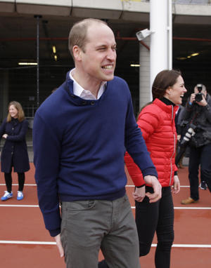 Britain's Prince William, Duke of Cambridge (L) shares a joke after running in a relay race, during a training event to promote the charity Heads Together, at the Queen Elizabeth Olympic Park in London, on February 5, 2017.
