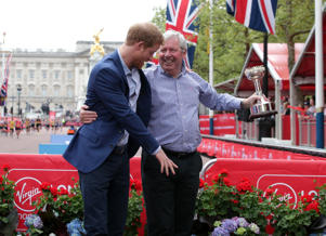 Prince Harry shares a joke with Brendan Foster during the Virgin Money London Marathon, London. PRESS ASSOCIATION. Picture date: Sunday April 23, 2017. See PA story ATHLETICS Marathon. Photo credit should read: Yui Mok/PA Wire (Photo by