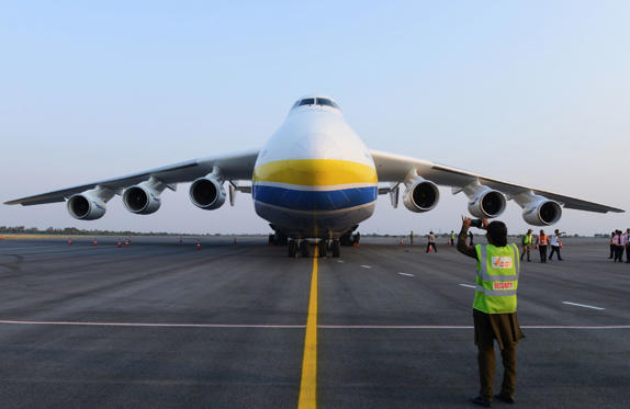 Slide 1 of 10: Indian Central Industrial Security Force (CISF) and airport personnel stand near the world's largest aircraft, the Antonov AN-225 Mriya, at Rajiv Gandhi International airport in Hyderabad on May 13, 2016. The six-engined Mriya aircraft, which means 'dream' in Ukranian, is the longest and heaviest airplane ever built and is en route to Australia from Europe / AFP / NOAH SEELAM (Photo credit should read NOAH SEELAM/AFP/Getty Images)