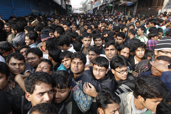 Slide 1 de 32: People gather in front of City Bank to buy tickets for the cricket World Cup in Dhaka January 2, 2011.