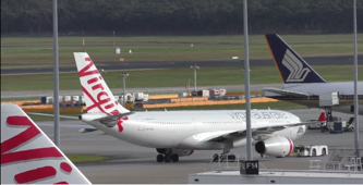 Virgin Australia's maiden flight to Hong Kong welcomes Richard Branson and water cannon 'salutes'